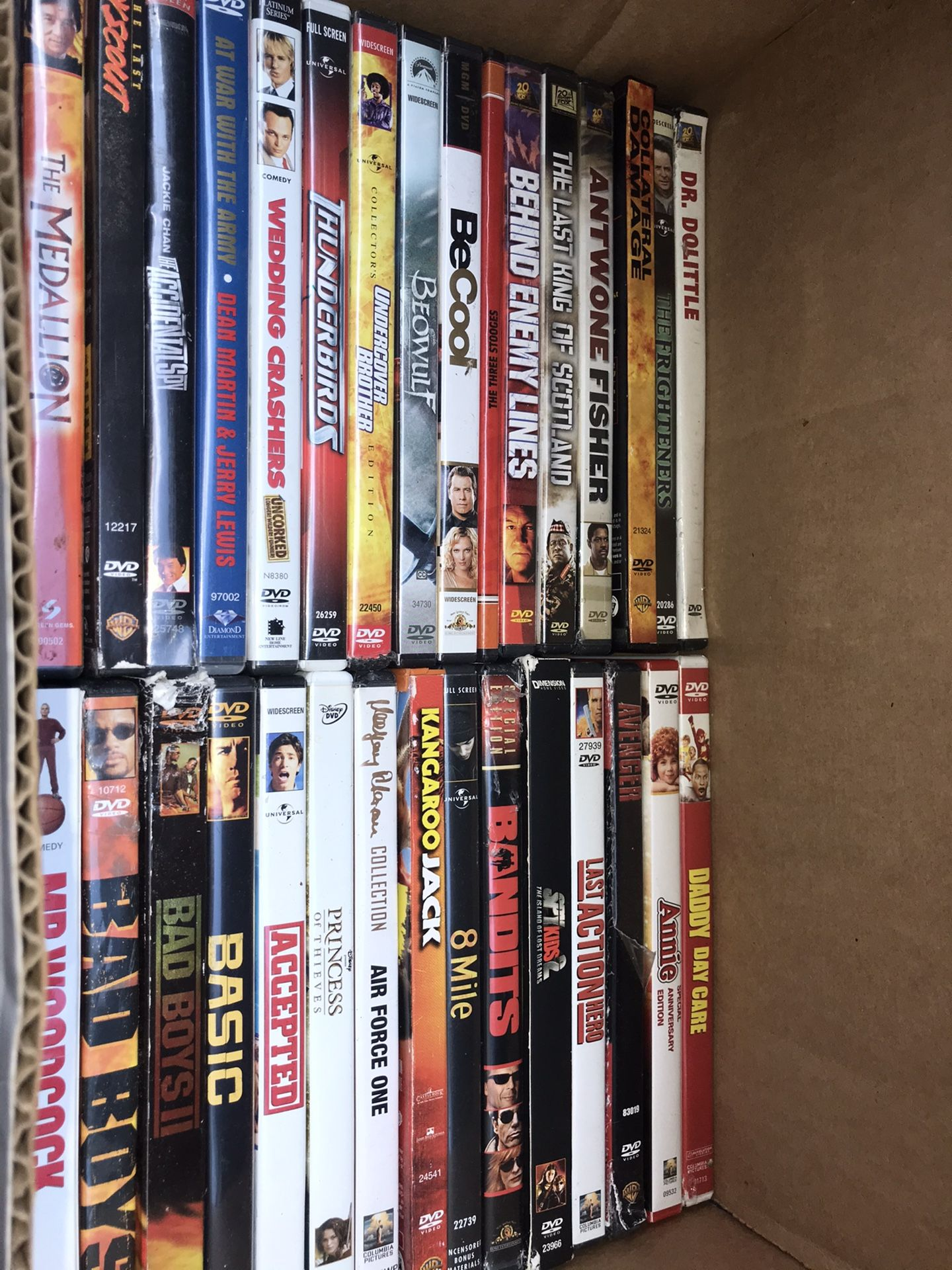 BOXES OF DVDS ADULT AND SOME CHILDRENS