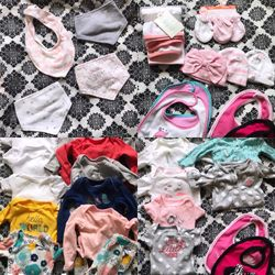 14 new outfits 4 blankets 2 packs of pampers with huggies wipes, bows, toys, and pacifiers Thumbnail