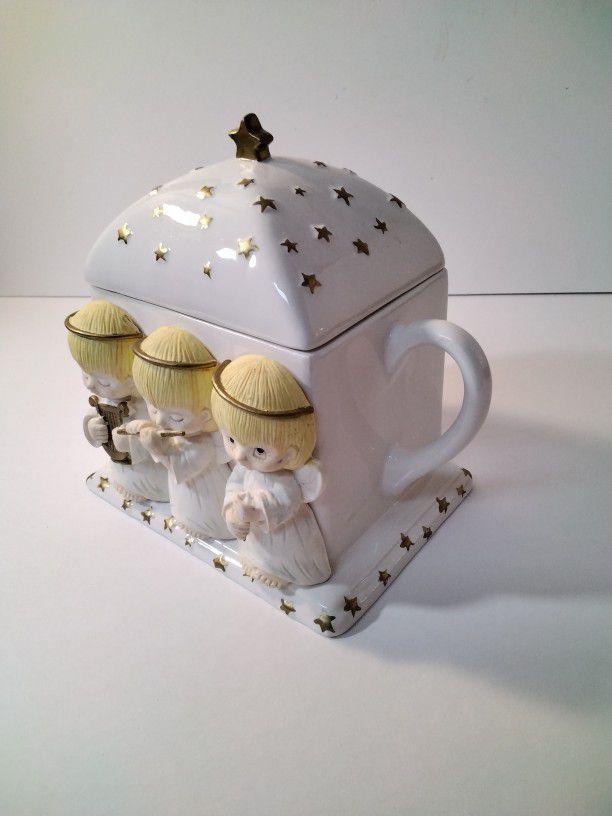 A Beautiful Tea Pot With Angels .