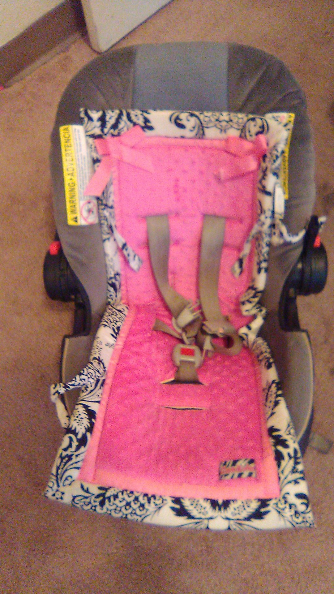 Graco car seat with pink seat cover