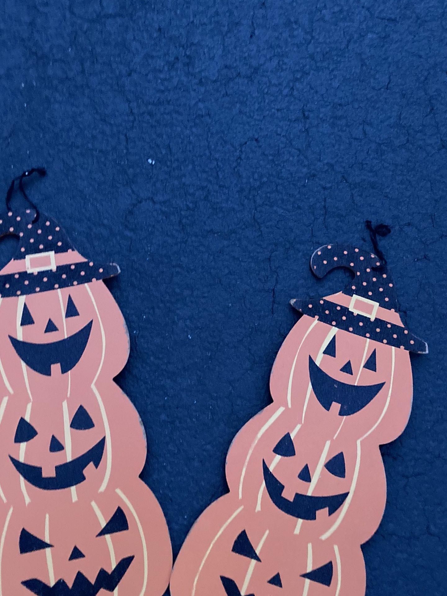 Two topiary pumpkin wall hangers