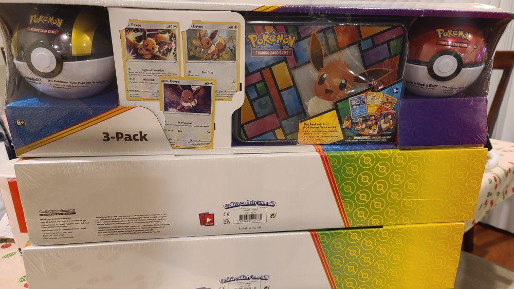 Pokemon 3 Pack Eevee Tin Box and 2 Pokemon Balls.