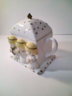 A Beautiful Tea Pot With Angels . Thumbnail