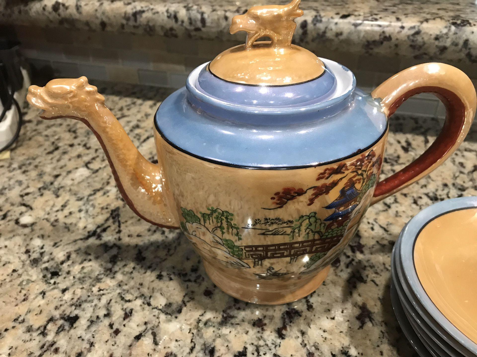 Antique dragon head tea pot and saucers. Asian oriental.