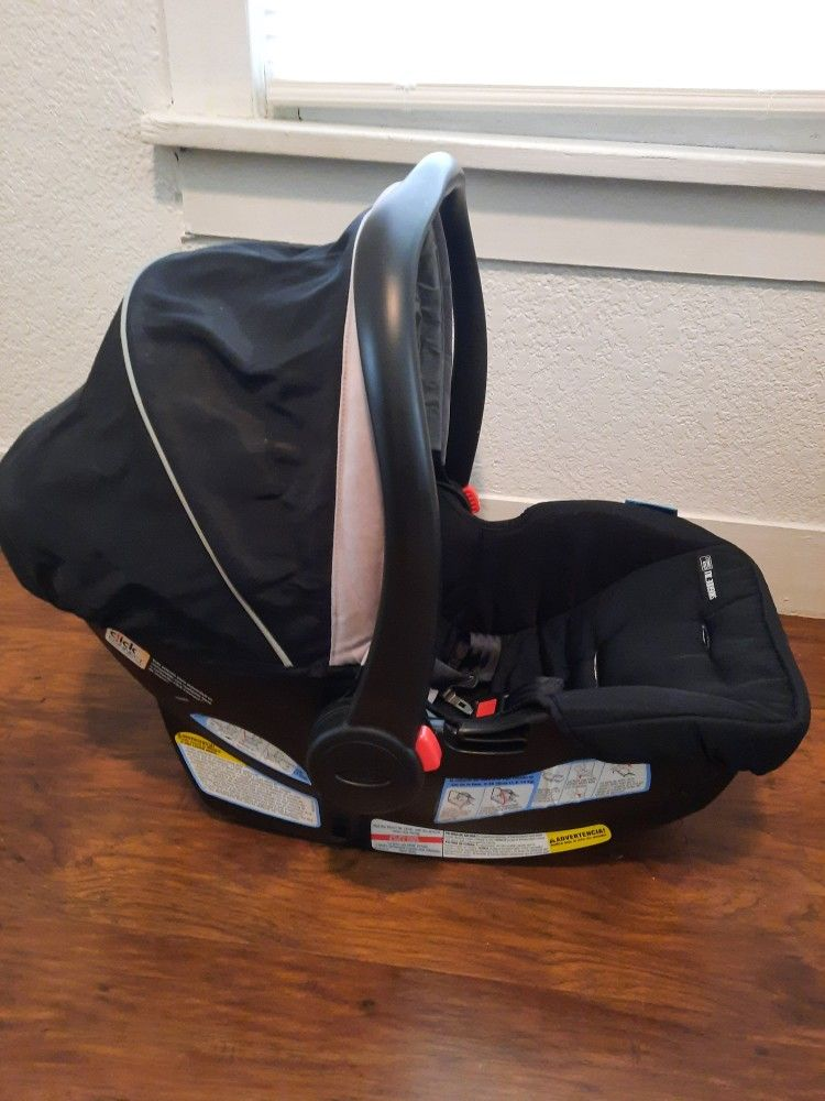 Graco FastAction Fold SE Travel System With SnugRide Infant Car Seat And Stroller