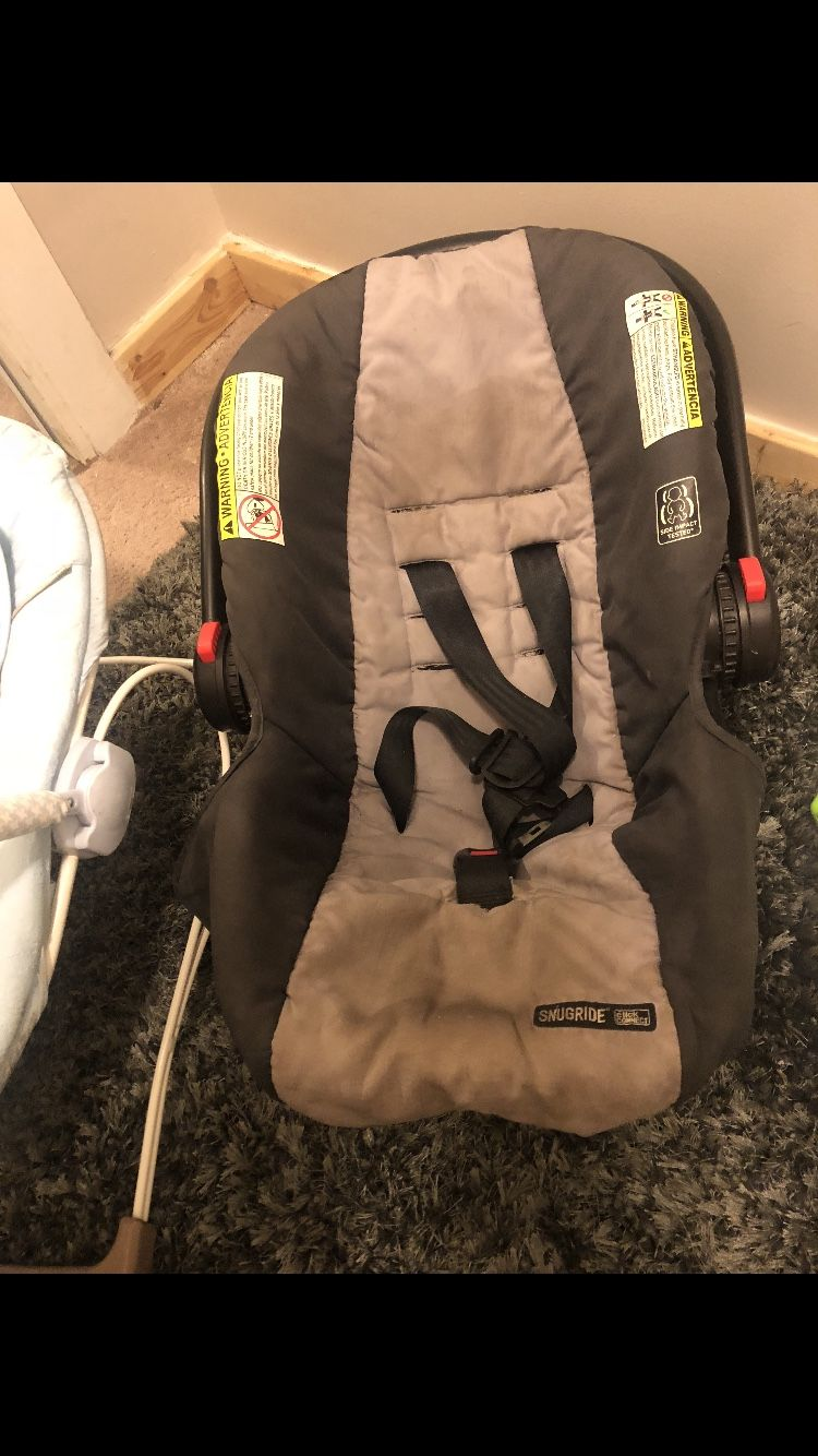 Baby bed, mattress, bouncer, activity seat , 3 bags of baby cloths car seat and excersor
