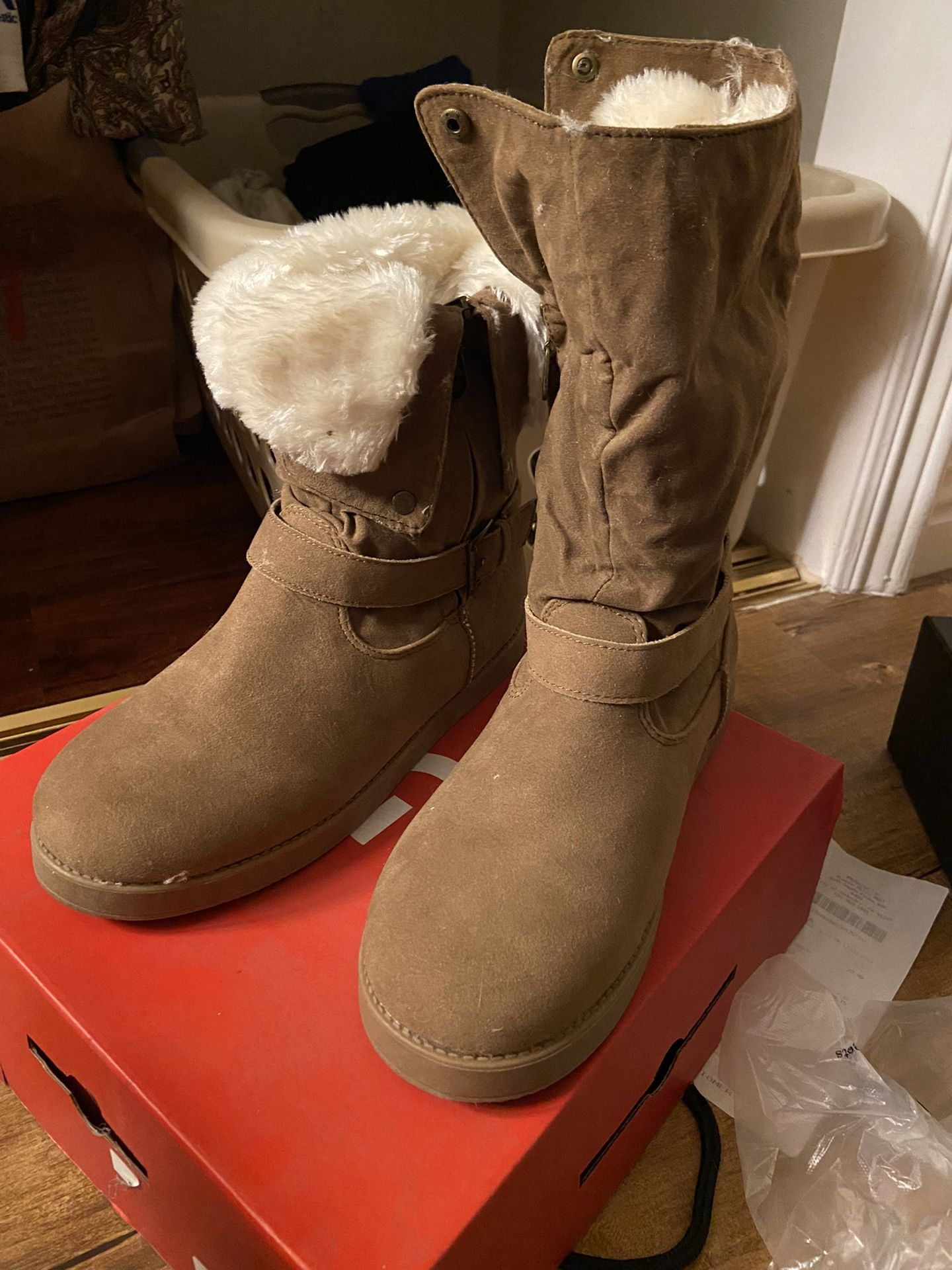 By Guess brown fur boot that is similar to UGGs