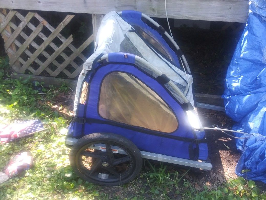 It is a bicycle trailer yes it is is a bicycle trailer yes it is a little kid