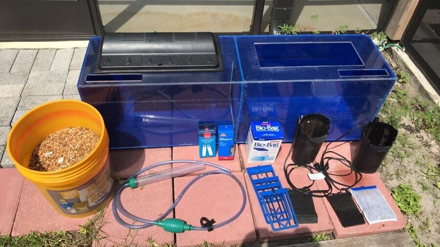 Fish tank with all necessary accessories: filter system, light and bulbs, bucket of gravel, gravel cleaner, fish not included but have goldfish and g