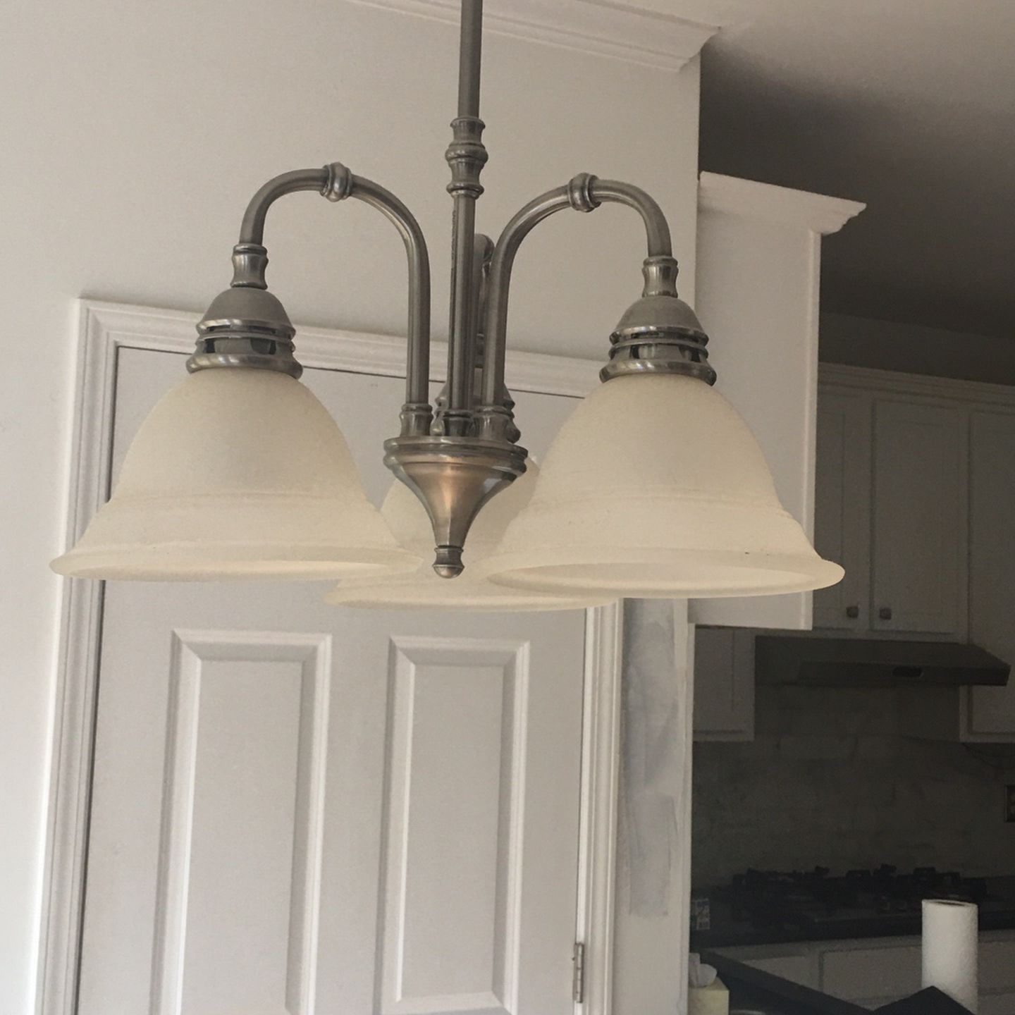 One Nickle and Frosted Glass Light Fixtures