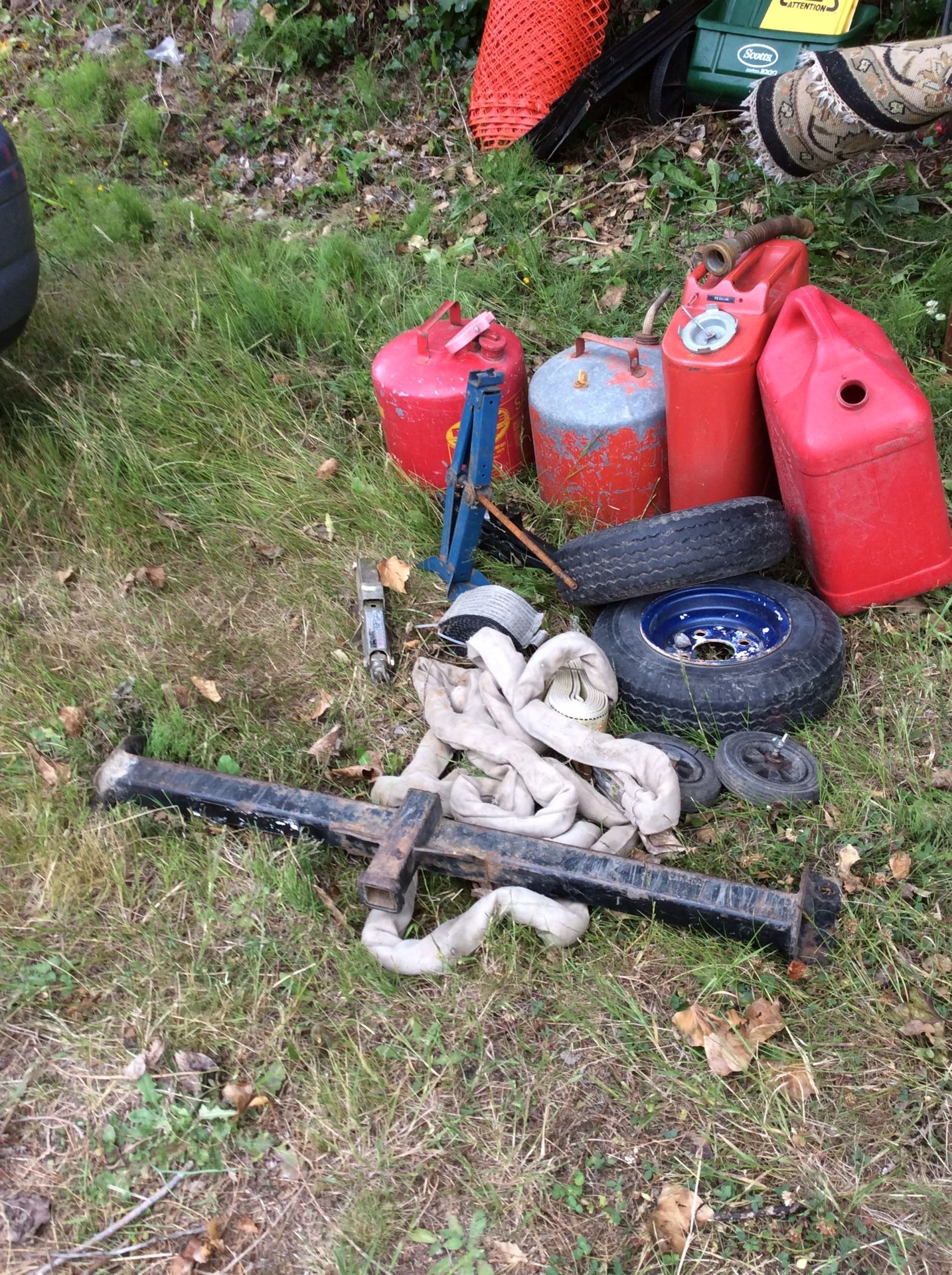 Gas can lot, tow straps, car jacks, trailer tires(2), tow hitch