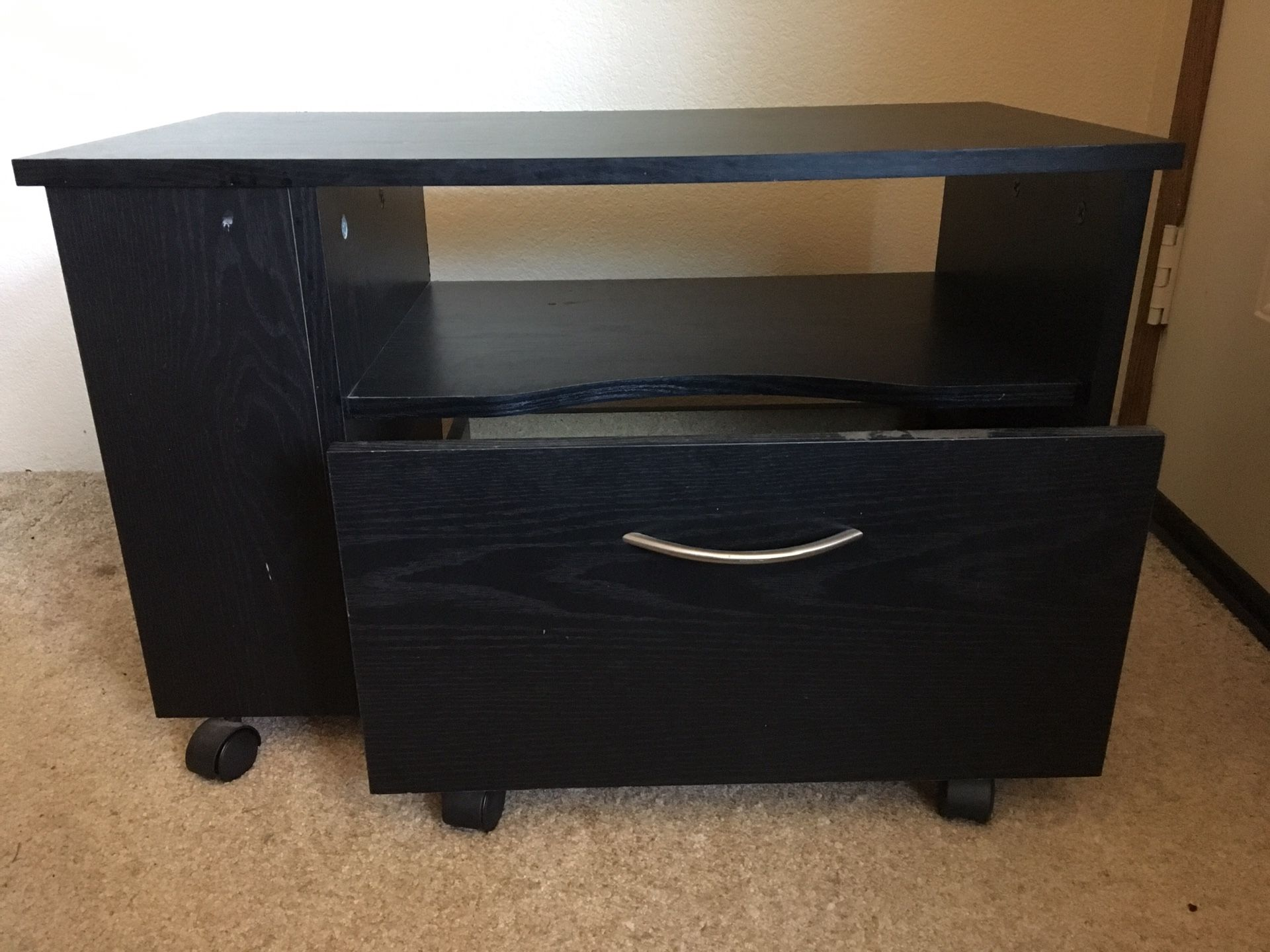 Small black stand with drawer.