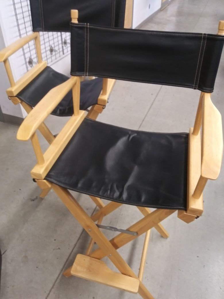 Very nice director chairs with extra brown interchangeable chair covers