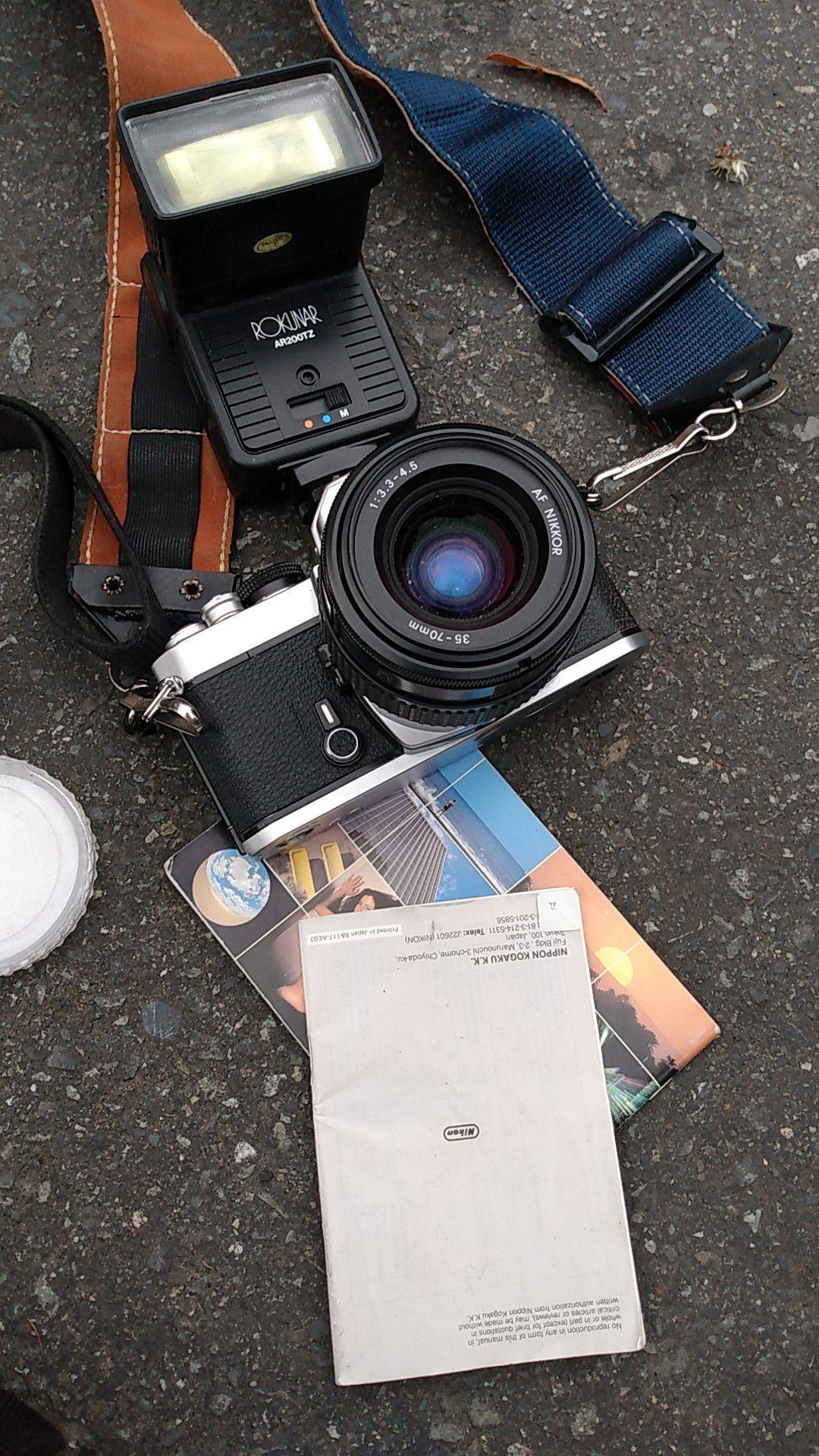 Nikon camera and three lenses