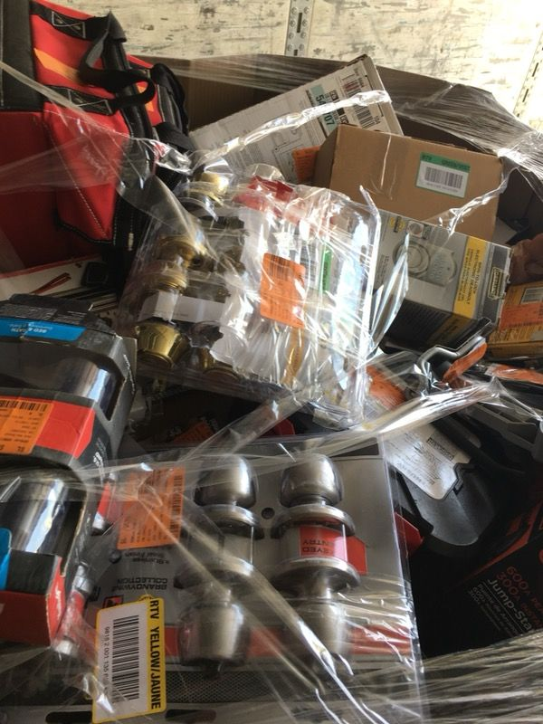 Pallet filled with locks, tools, and hardware for resale