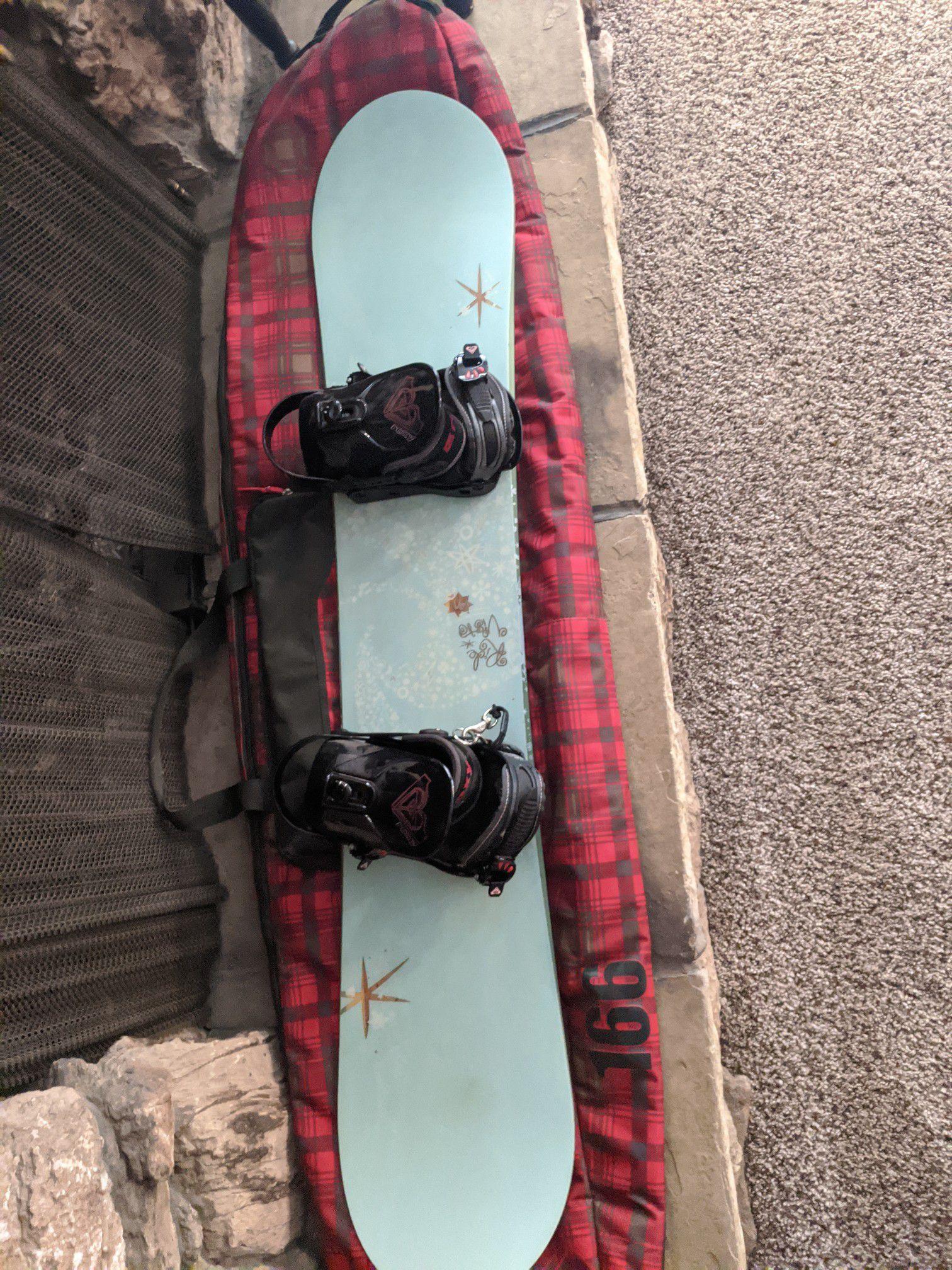 Snowboard, bindings, bag