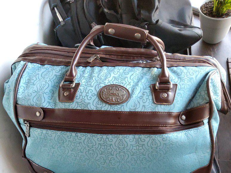 Reba Santa Fe IV Rolling Luggage Bag
