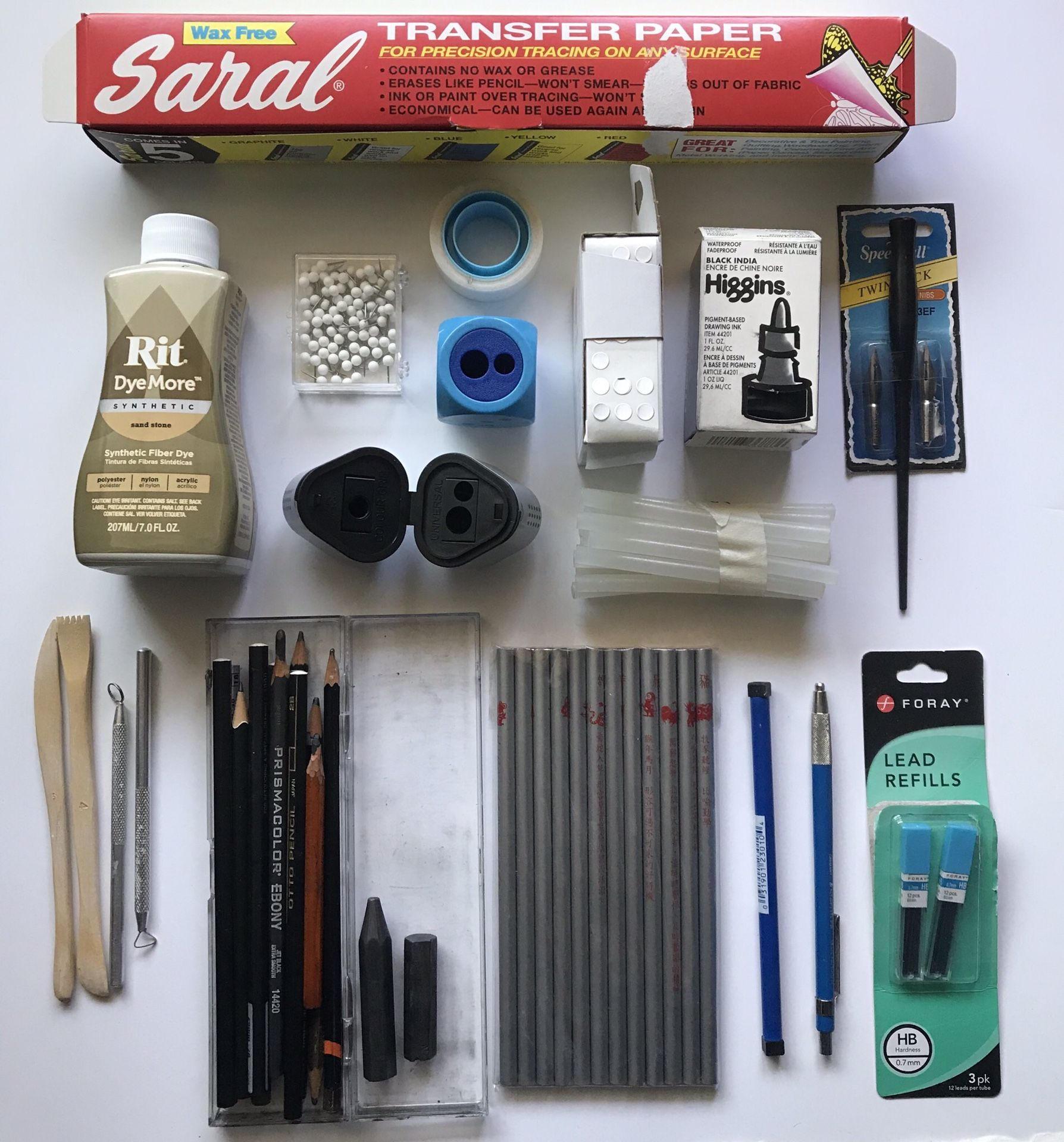 A box of drawing and crafting supplies