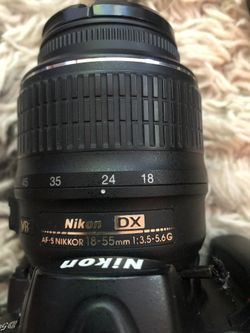 Nikon D5000 plus two lenses, carry case, charger and more Thumbnail