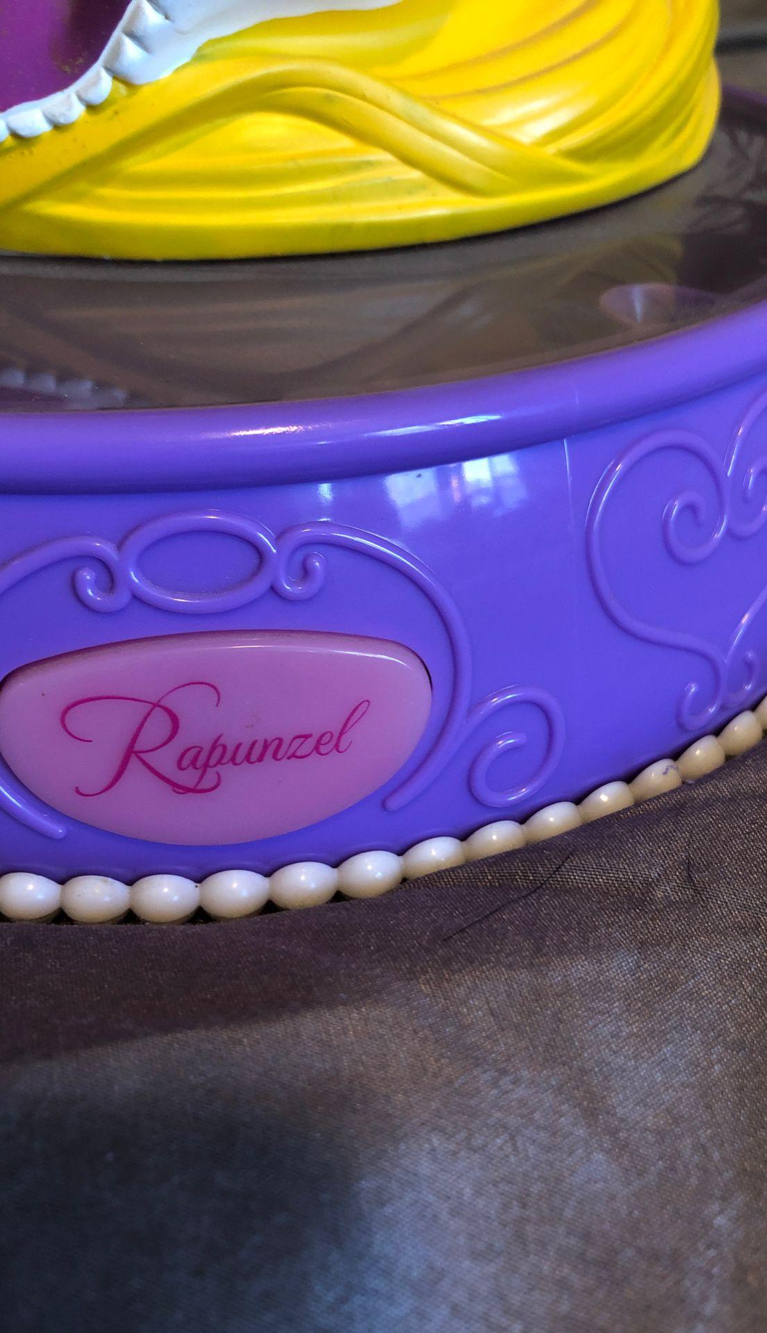 Rapunzel singing piggy bank