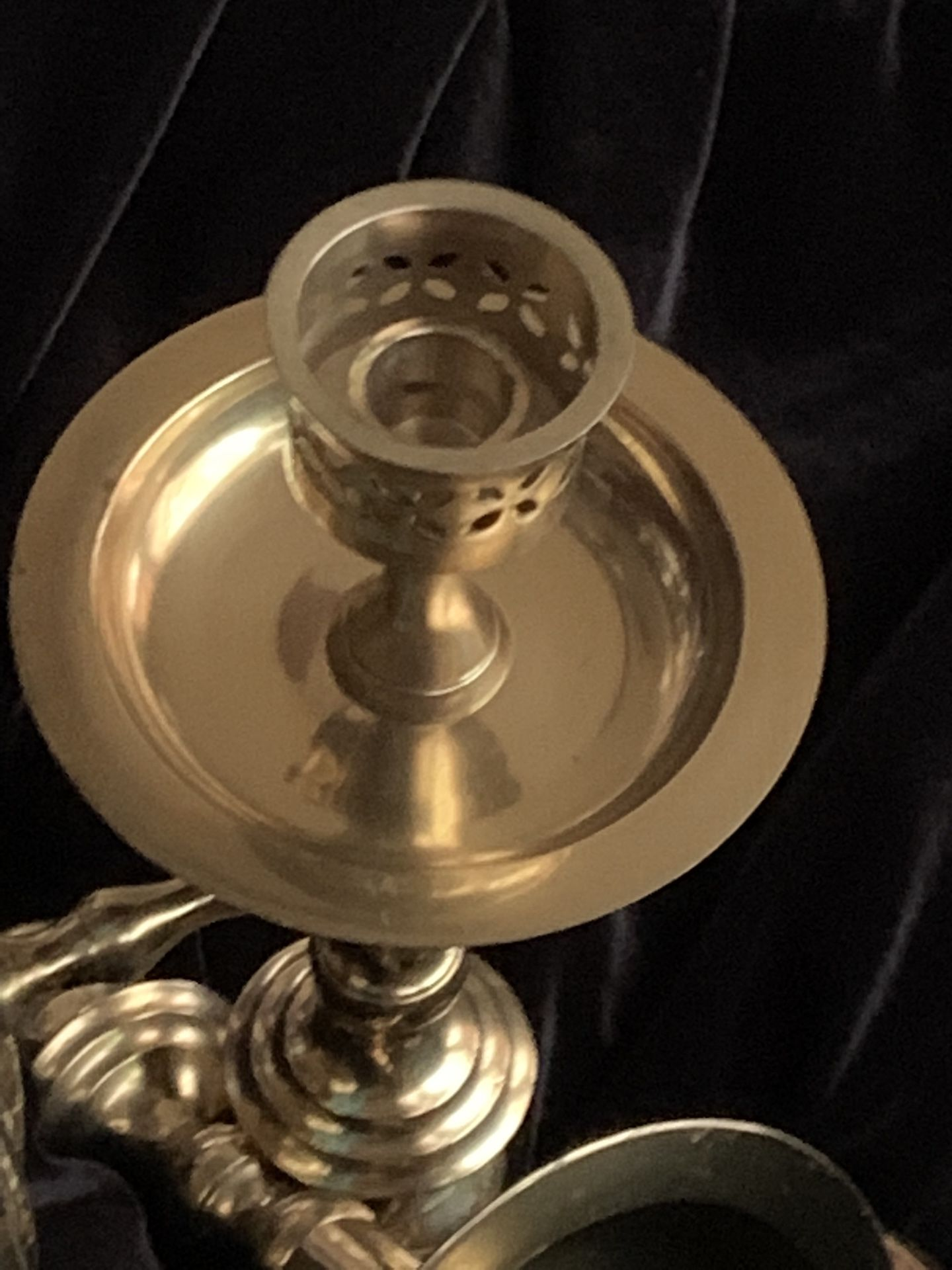 Brass wall candle holders.