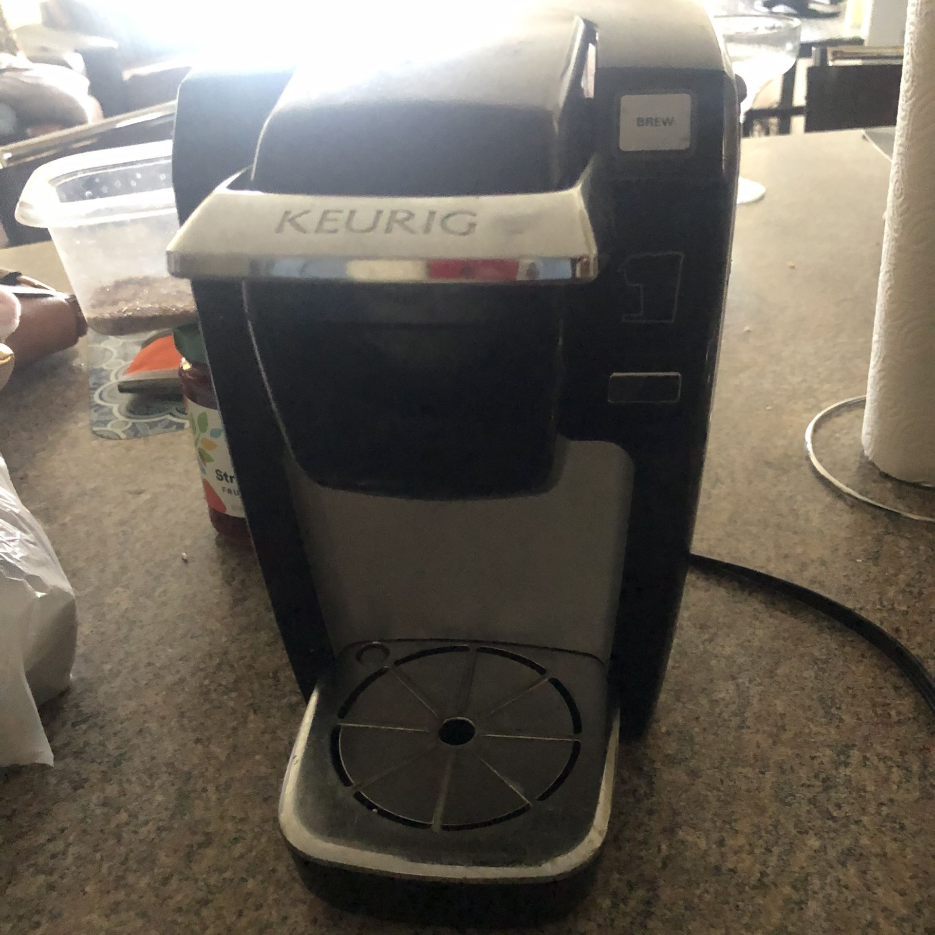 Kurieg and coffee cup holder