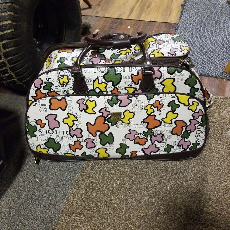 Tous Carryon Rolling Duffle Bag