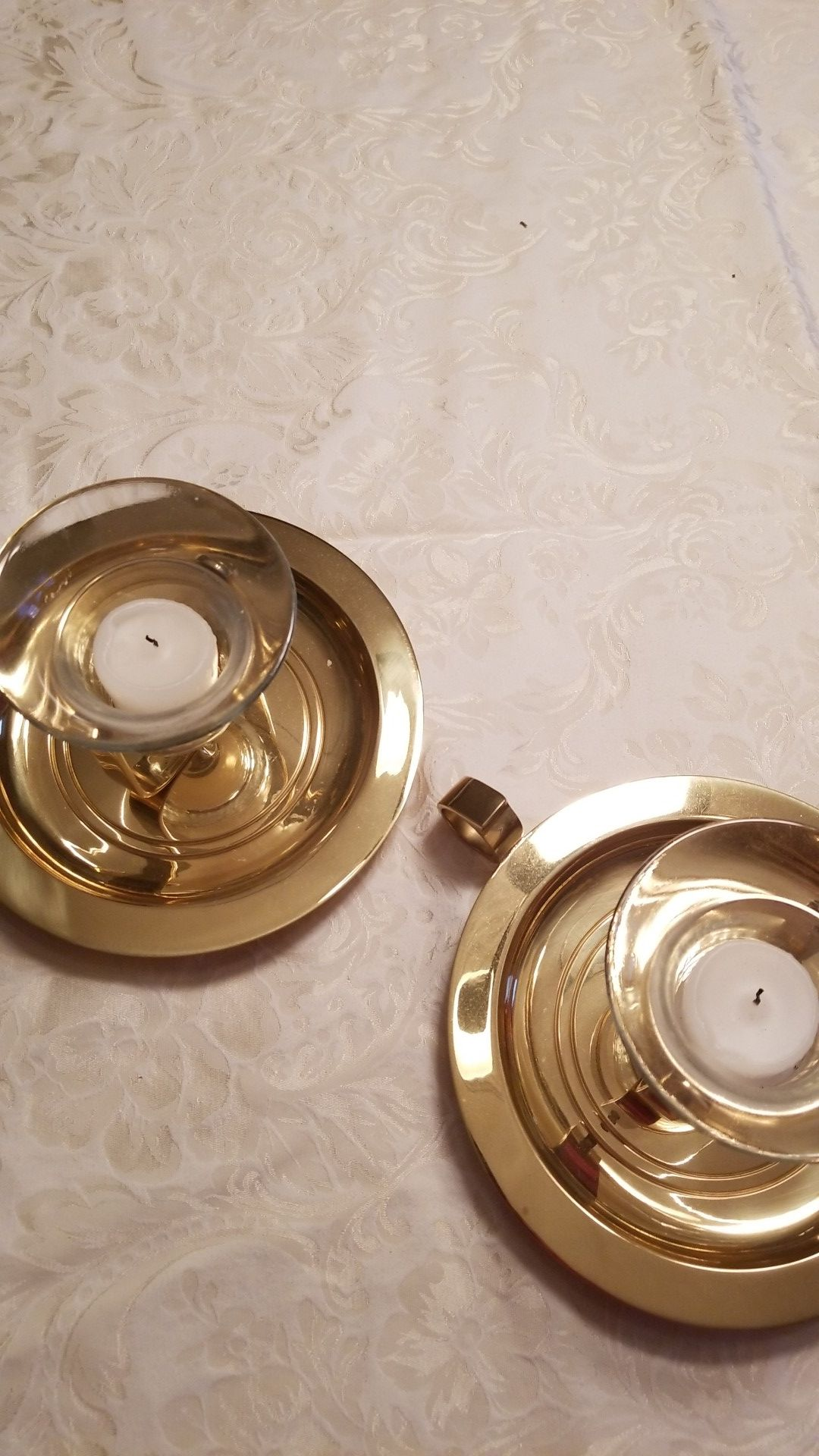 Brass candle holders, either free standing or can be hung on wall