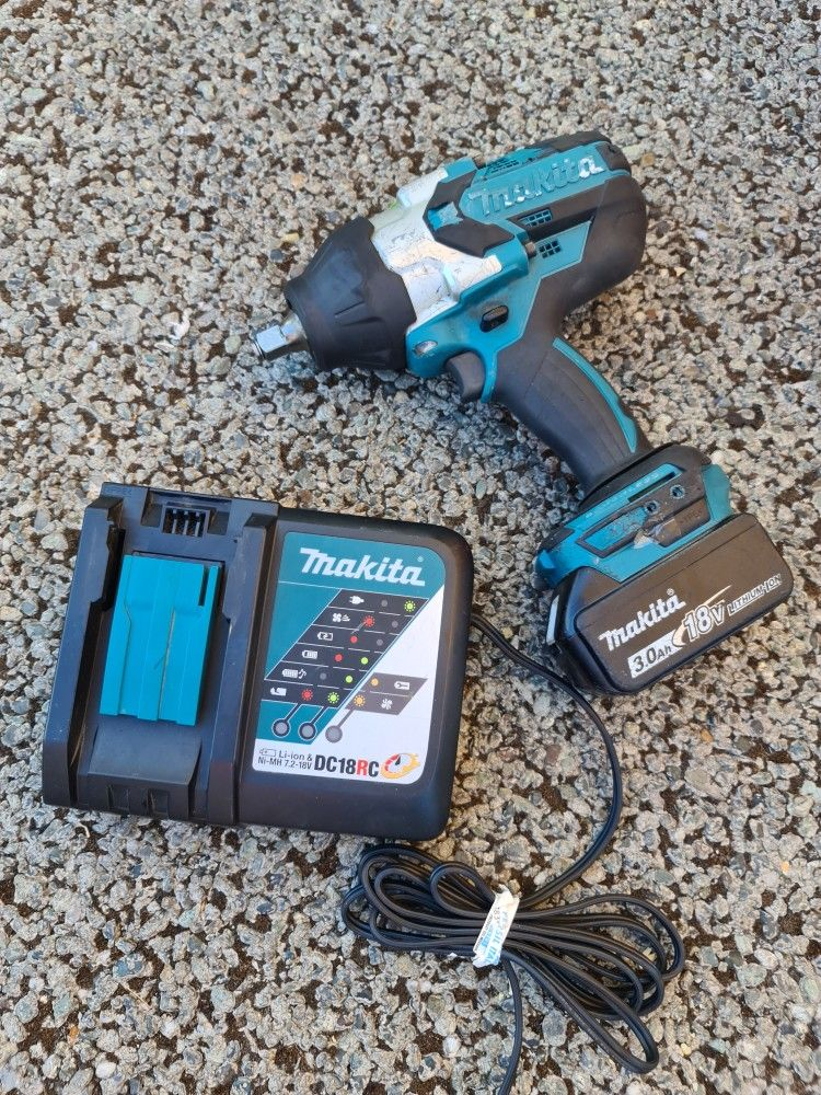 Makita 18-Volt LXT Lithium-Ion Brushless Cordless High Torque 1/2 in. Square Drive Impact Wrench w/ (1) Battery And Charger.