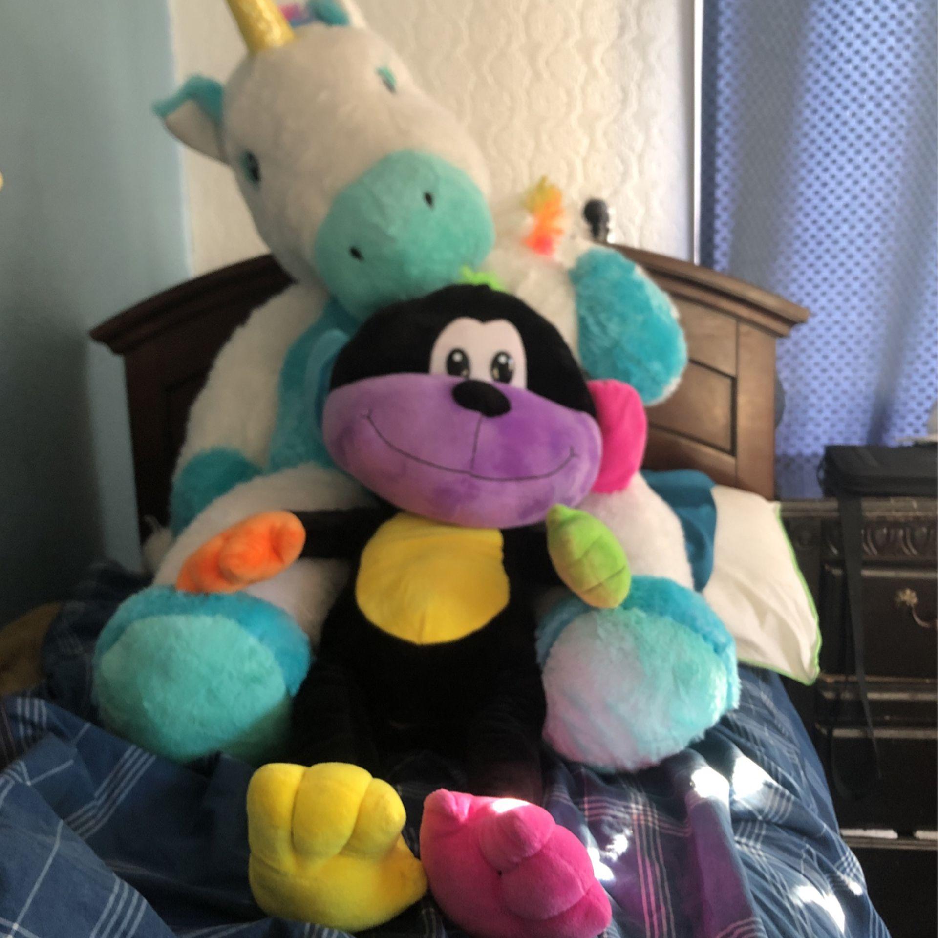 Extra large stuffed unicorn and large monkey