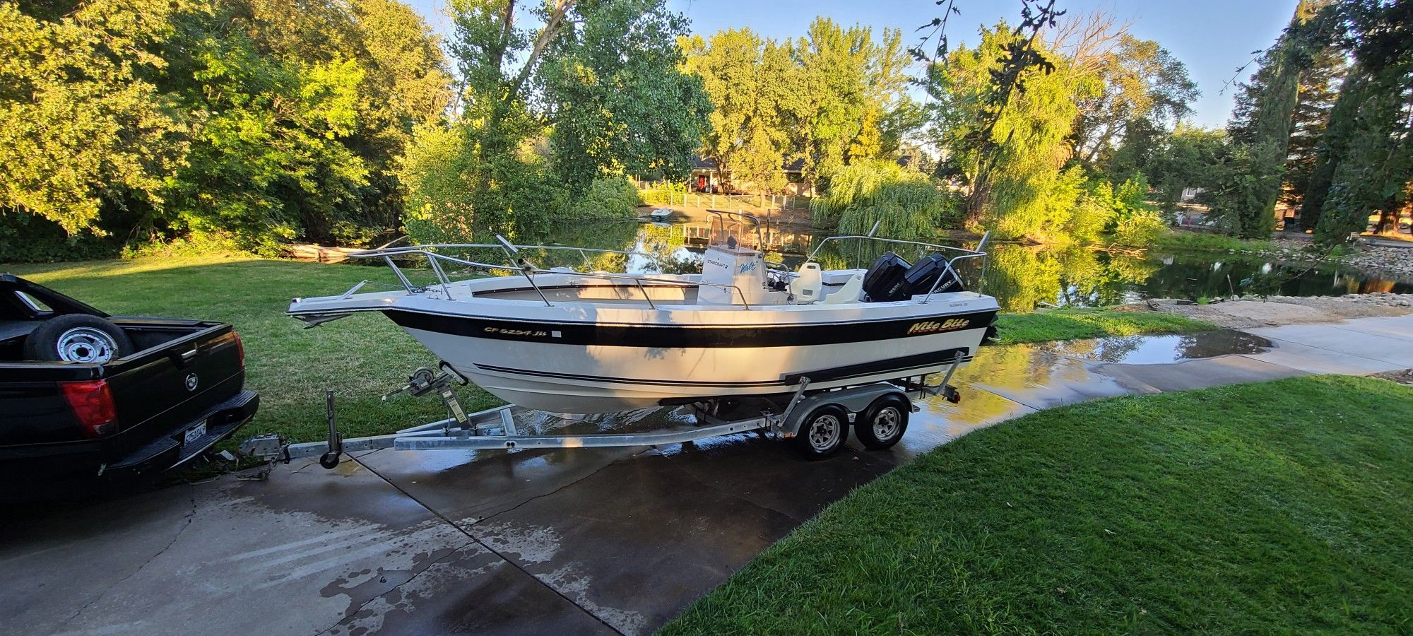 BLUEWATER 210 CENTER CONSOLE BOAT W/ 2 MERCURY 115 OUTBOARDS