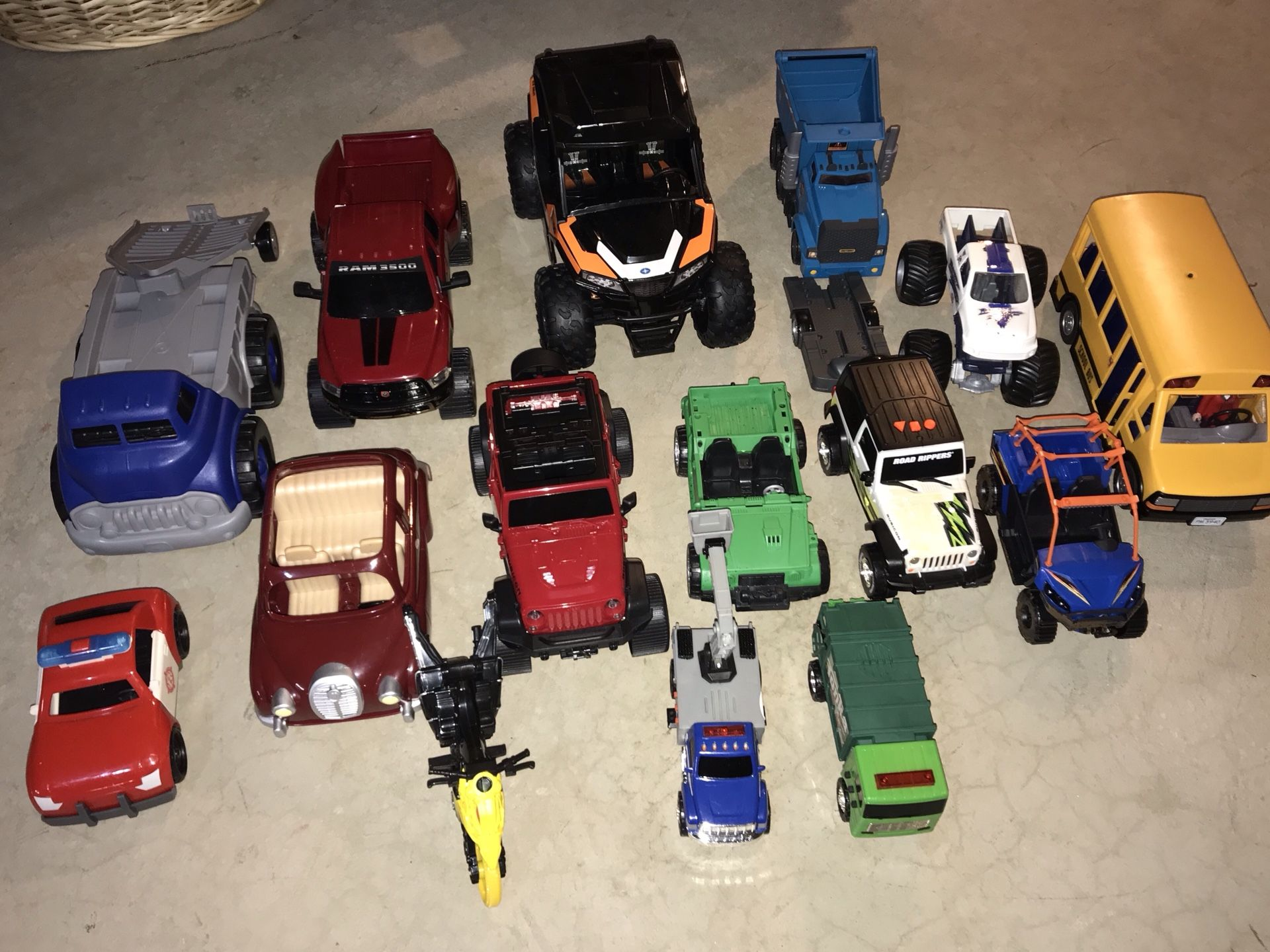 Huge lot of 15 trucks, cars, motorcycle, buss, two with trailers. Also includes dump truck, tow truck, monster truck.