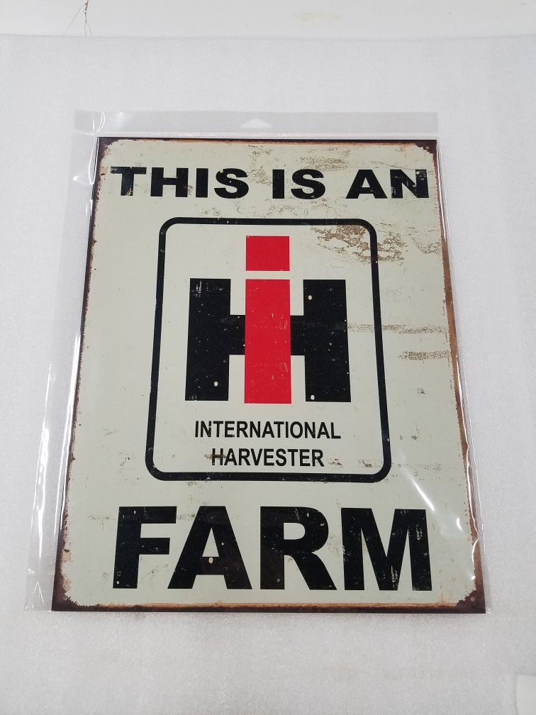 This is a international harvester farm tractor metal sign
