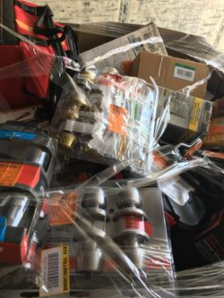 Pallet filled with locks, tools, and hardware for resale Thumbnail