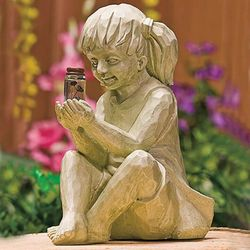 Creatively Statues Of 2 Kids Holding Fireflies. Thumbnail
