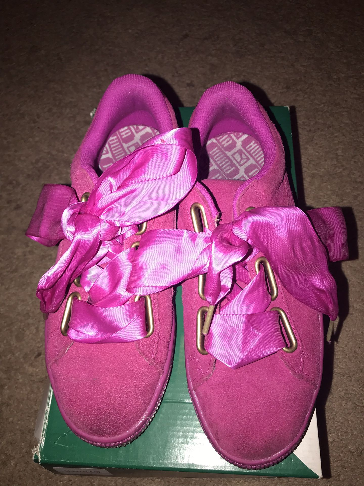 Gently used size 7 hot pink puma shoes with satin bow laces