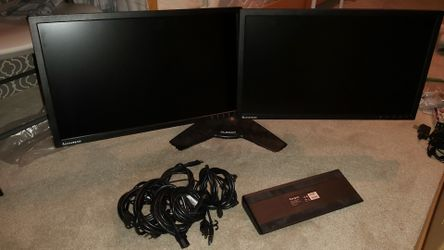 Lenovo dual monitor setup with stands and cables Thumbnail