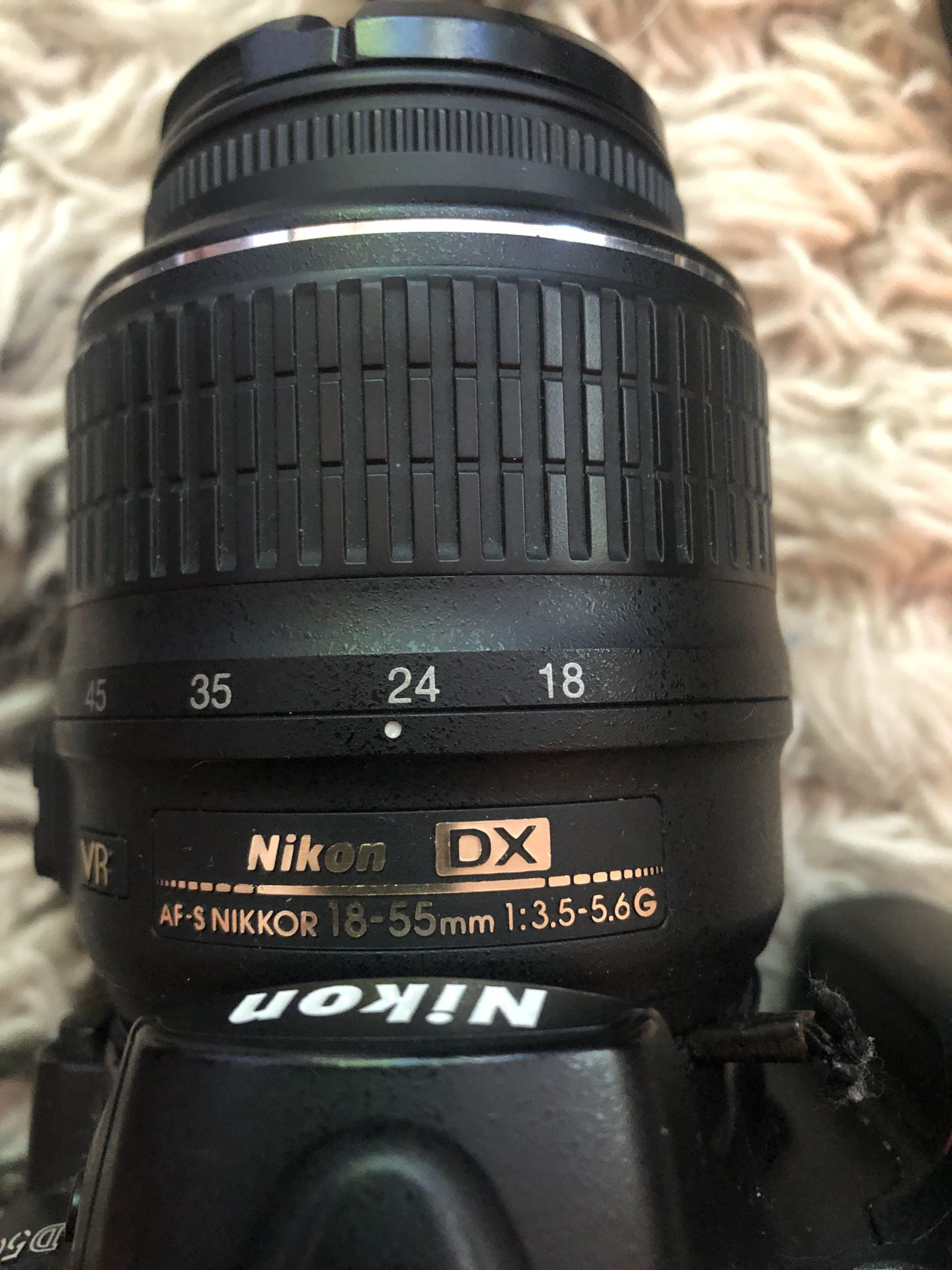 Nikon D5000 plus two lenses, carry case, charger and more