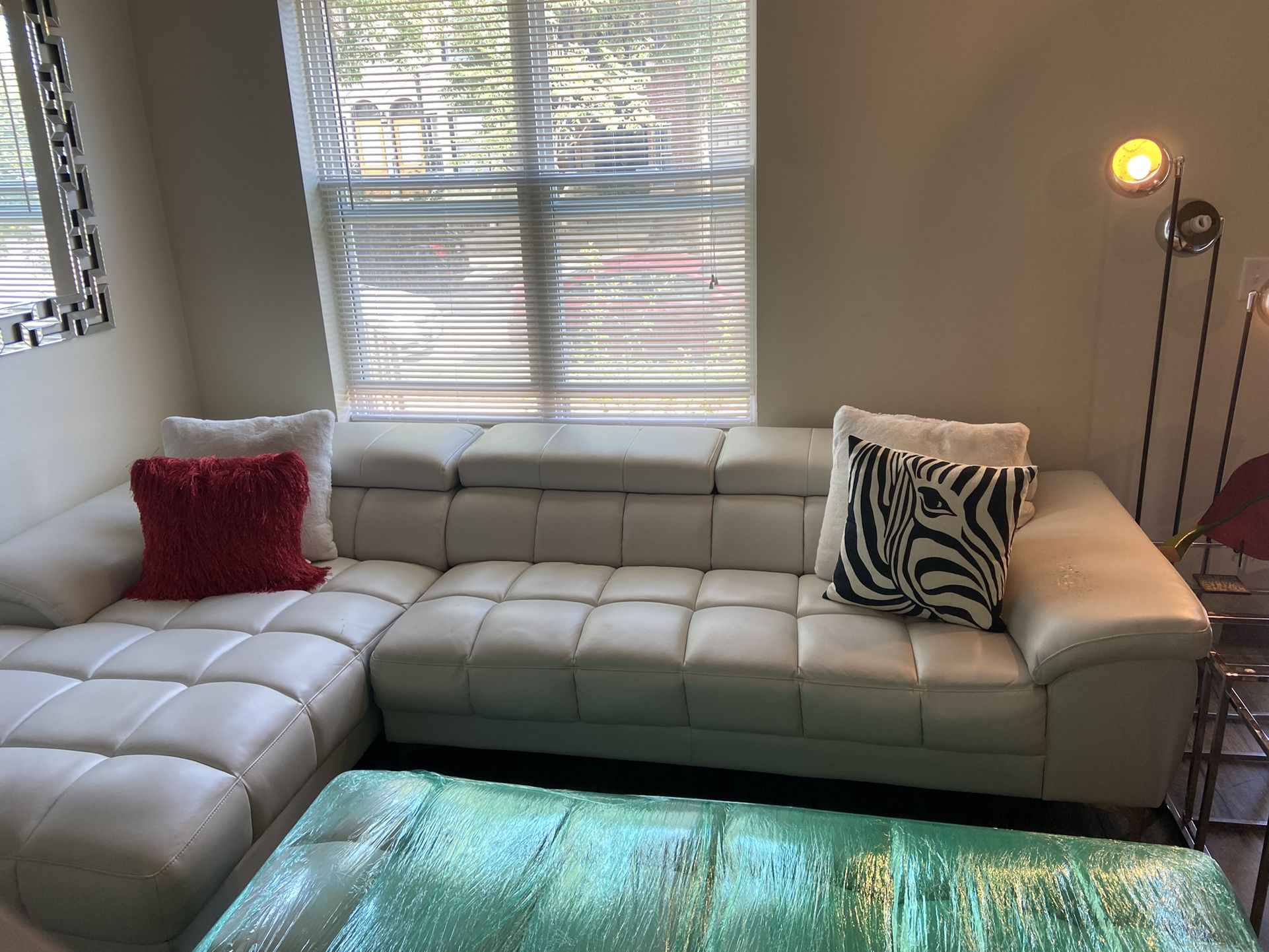 Off White Faux Leather Sectional /ottoman