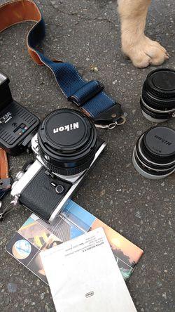 Nikon camera and three lenses Thumbnail
