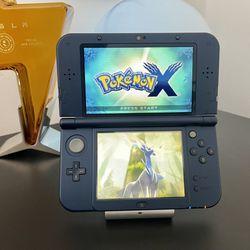 New Nintendo 3DS Metallic Blue W/ 128gb of Games Thumbnail