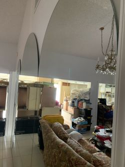 Three(3) Large mirrors oval shape on top, one large 2 Medium Size asking $390. Obo today Thumbnail