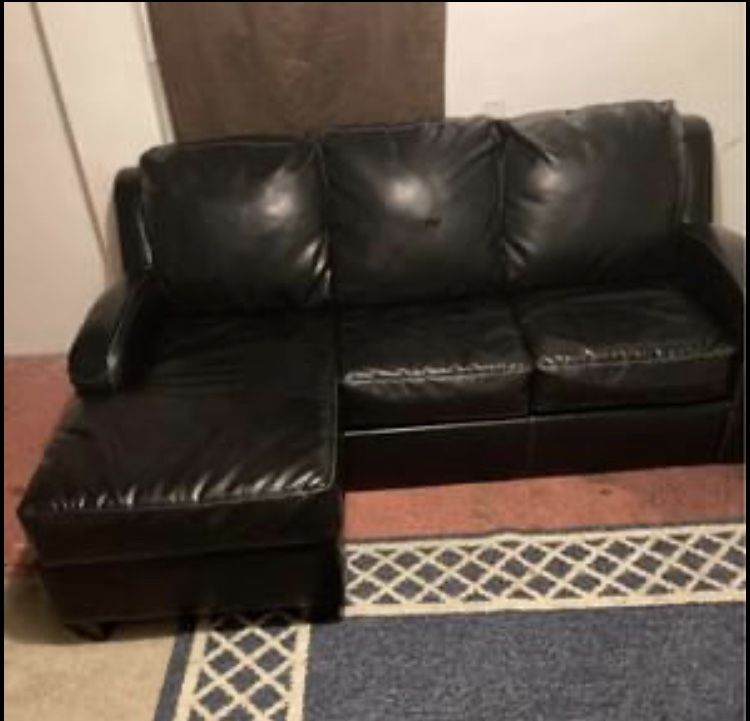 black leather sleeper ottoman sofa Folds Out To A Bed