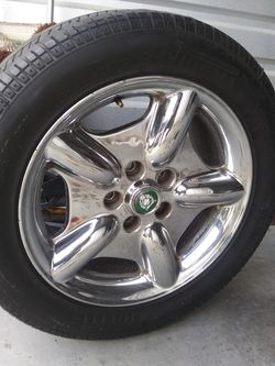Jaguar 17 inch chrome revolver rims set of 4... One tire needs to be replaced, all Pirelli! Minor scuffs but still a nice set af wheels.. Thumbnail