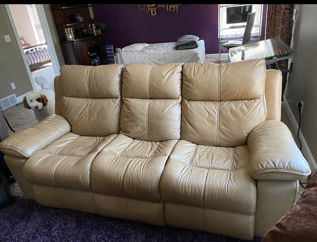 Tan leather sofa set is for sale Ana- they are power recliners. Price 1600