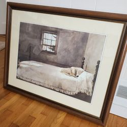 A dog in a bed Framed Art Thumbnail