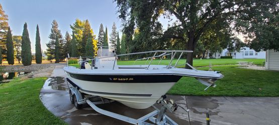BLUEWATER 210 CENTER CONSOLE BOAT W/ 2 MERCURY 115 OUTBOARDS Thumbnail