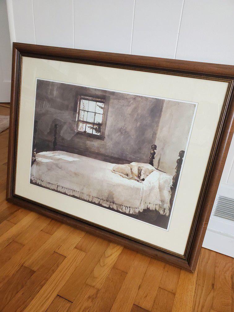 A dog in a bed Framed Art