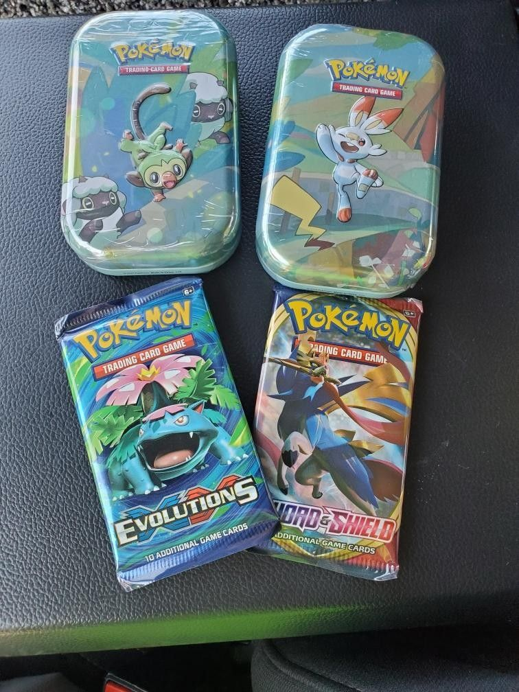 XY Evolutions Mini Tins Booster Pack $20