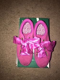 Gently used size 7 hot pink puma shoes with satin bow laces Thumbnail